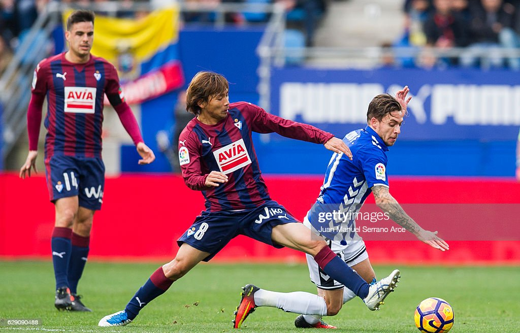 Takashi Inui of SD Eibar duels for the ball with Francisco Femenia of Deportivo Alaves during the La Liga match between SD Eibar and Deportivo Alaves at Ipurua Municipal Stadium on December 11, 2016 in Eibar, Spain.