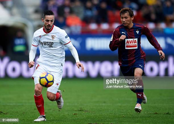 Takashi Inui of SD Eibar duels for the ball with Pablo Sarabia of Sevilla FC during the La Liga match between SD Eibar and Sevilla FC at Ipurua...
