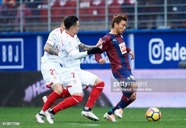 Takashi Inui of SD Eibar duels for the ball with Roque Mesa of Sevilla FC during the La Liga match between SD Eibar and Sevilla FC at Ipurua...