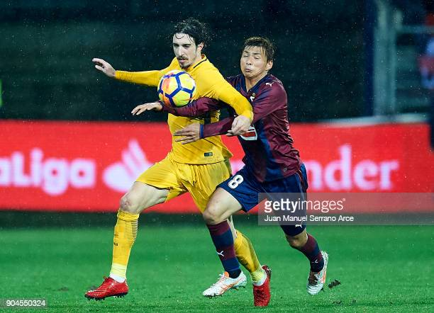 Takashi Inui of SD Eibar duels for the ball with Sime Vrsaljko of Atletico Madrid during the La Liga match between SD Eibar and Atletico Madrid at...