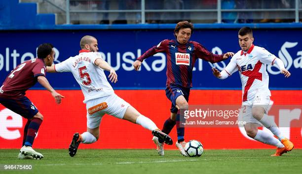 Takashi Inui of SD Eibar duels for the ball with Victor Laguardia of Deportivo Alaves during the La Liga match between SD Eibar and Deportivo Alaves...