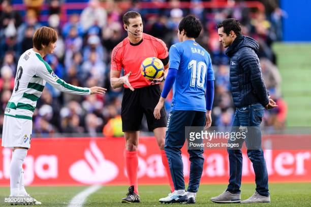 Takashi Inui of SD Eibar Fifa Referee Alberola Rojas with special guest Javier Fernandez Spanish Figure Skater who kickoff the match and Gaku...