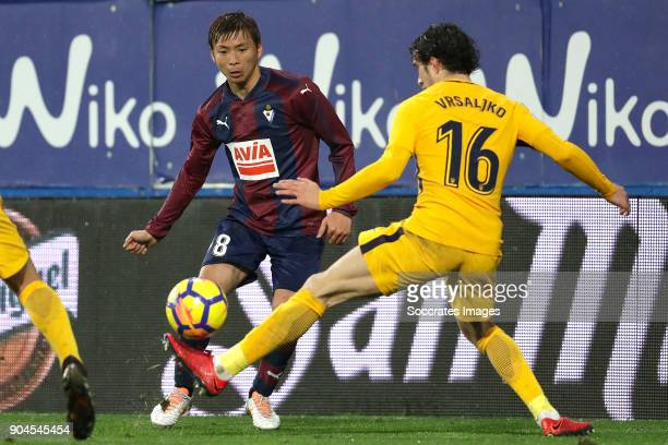 Takashi Inui of SD Eibar Sime Vrsaljko of Atletico Madrid during the La Liga Santander match between Eibar v Atletico Madrid at the Estadio Municipal...