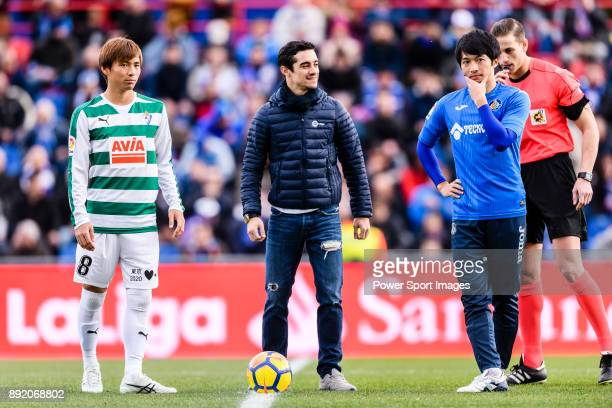 Takashi Inui of SD Eibar with special guest Javier Fernandez Spanish Figure Skater who kickoff the match and Gaku Shibasaki of Getafe CF during the...