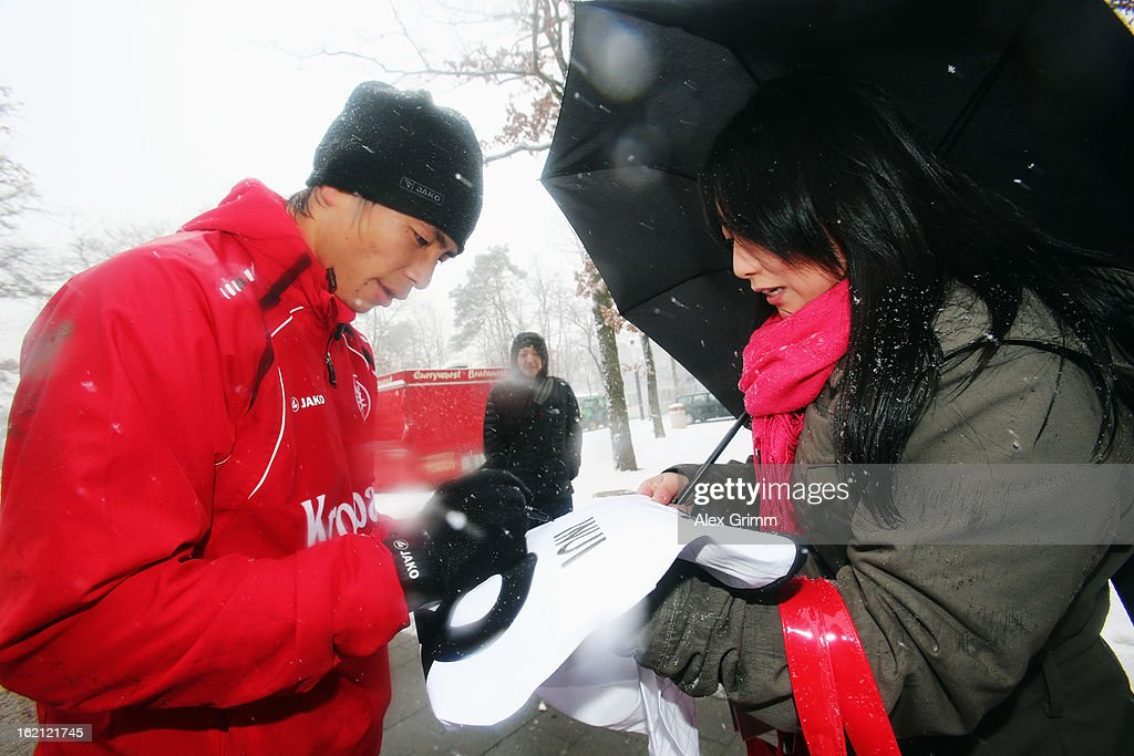 Takashi Inui signs autographs during a Eintracht Frankfurt training session at Commerzbank-Arena on February 19, 2013 in Frankfurt am Main, Germany.