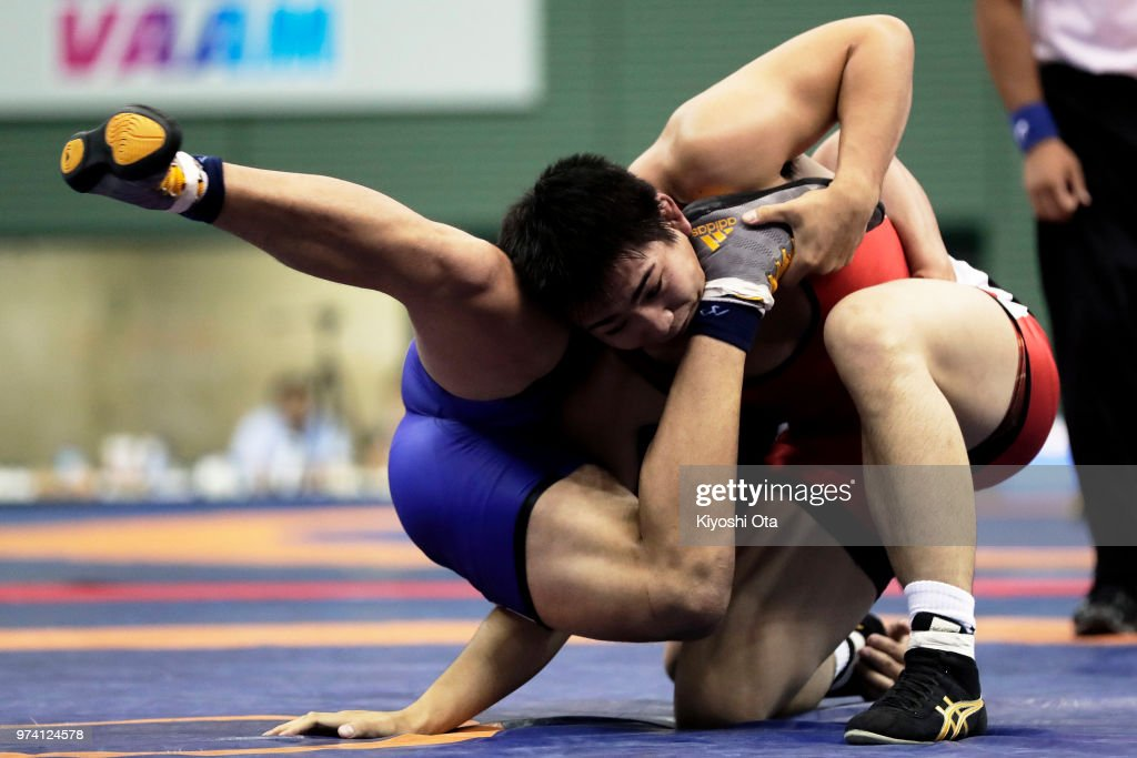 Takashi Ishiguro (R) competes against Keiwan Yoshida in the Men's Freestyle 92kg semifinal match on day one of the All Japan Wrestling Invitational Championships at Komazawa Gymnasium on June 14, 2018 in Tokyo, Japan.