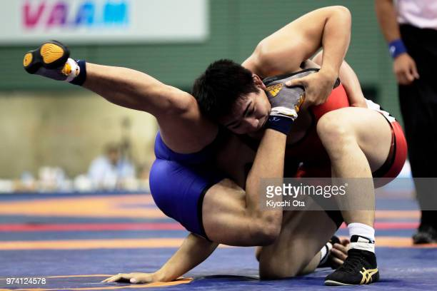 Takashi Ishiguro competes against Keiwan Yoshida in the Men's Freestyle 92kg semifinal match on day one of the All Japan Wrestling Invitational...