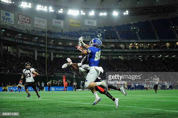 Takashi Kameyama of the Fighters misses a catch in the end zone against ALRilwan Adeyami of the Frontiers during the Rice Bowl match between Fujitsu...