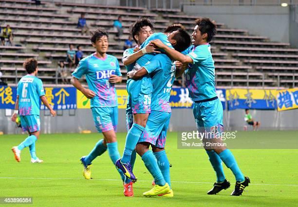 Takashi Kanai of Sagan Tosu celebrates scoring his team's first goal with his teammates during the Emperor's Cup third round match between Sagan Tosu...