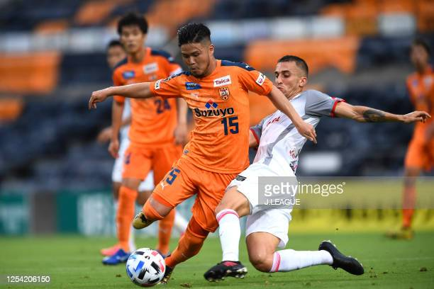 Takashi Kanai of Shimizu S-Pulse is tackled by Joao Schmidt of Nagoya Grampus during the J.League Meiji Yasuda J1 match between Shimizu S-Pulse and...