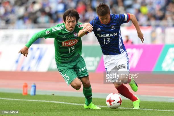 Takashi Kanai of the Yokohama F.Marinos and Masaru Kato of the Albirex Niigata compete for the ball during the J.League J1 match between Yokohama...