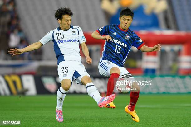 Takashi Kanai of Yokohama F.Marinos and Jungo Fujimoto of Gamba Osaka compete for the ball during the J.League J1 match between Yokohama F.Marinos...