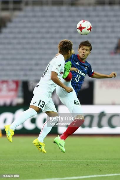 Takashi Kanai of Yokohama F.Marinos and Keijiro Ogawa of Vissel Kobe compete for the ball during the J.League J1 match between Yokohama F.Marinos and...