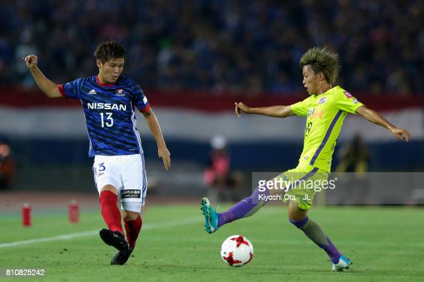 Takashi Kanai of Yokohama F.Marinos and Tsukasa Morishima of Sanfrecce Hiroshima compete for the ball during the J.League J1 match between Yokohama...