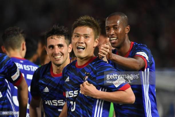 Takashi Kanai of Yokohama F.Marinos celebrates scoring his side's second goal with his team mate Martinus during the J.League J1 match between...