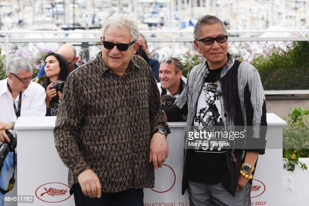 Takashi Miike and Jeremy Thomas attend the Blade Of The Immortal photocall during the 70th annual Cannes Film Festival at Palais des Festivals on May...