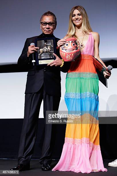 Takashi Miike and Nicoletta Romanoff arer seen on stage at the The Maverick Director Award Ceremony during the 9th Rome Film Festival on October 18...