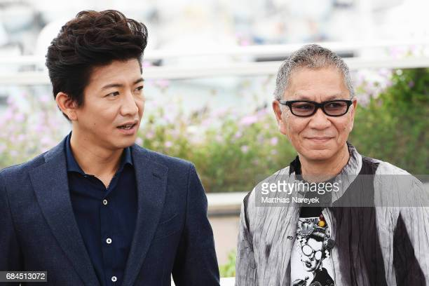 Takashi Miike and Takuya Kimura attend the 'Blade Of The Immortal ' photocall during the 70th annual Cannes Film Festival at Palais des Festivals on...