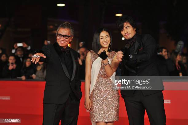 Takashi Miike Fumi Nikaidô and Hideaki Itô attend the Opening Night and Waiting For The Sea Premiere during the 7th Rome Film Festival at the...