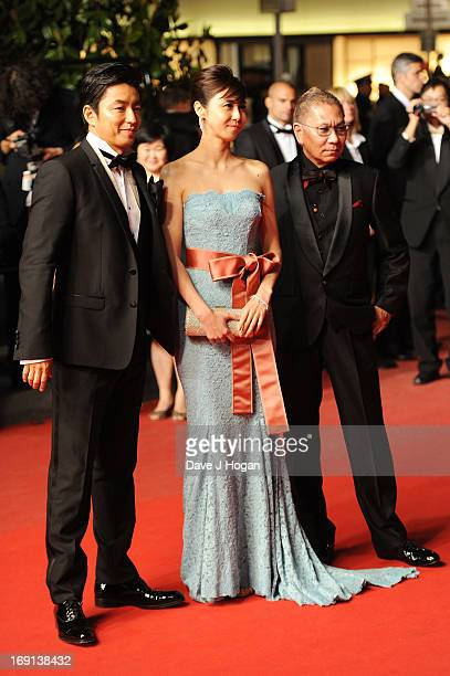 Takashi Miike Nanako Matsushima and Takao Osawa attend the 'Wara No Tate' Premiere during the 66th Annual Cannes Film Festival at the Palais des...