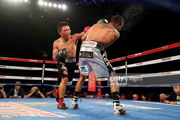 Takashi Miura connects a left punch to Miguel Berchelt in the eleventh round of the WBC Super Featherweight Title Fight at The Forum on July 15 2017...