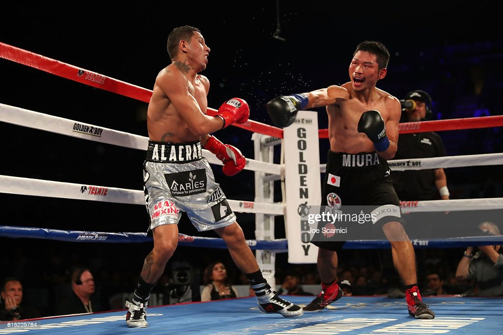 Takashi Miura connects a left punch to Miguel Berchelt in the tenth round of the WBC Super Featherweight Title Fight at The Forum on July 15, 2017 in Inglewood, California.