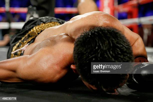 Takashi Miura is knocked down in the ninth round against Francisco Vargas during their WBC super featherweight title fight at the Mandalay Bay Events...