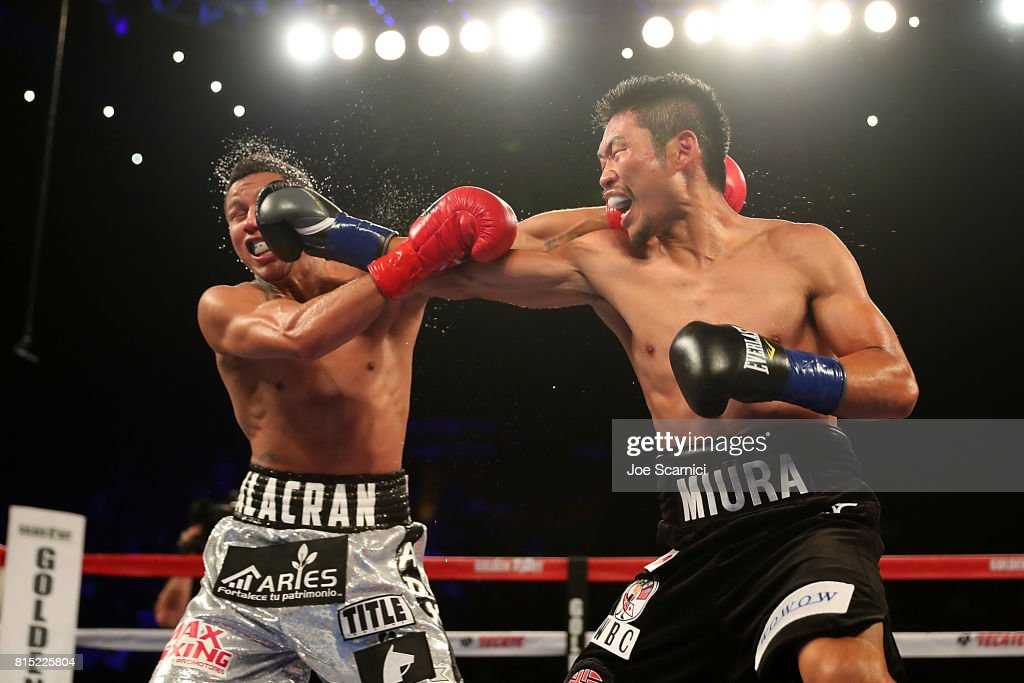 Takashi Miura sends a right punch to connect with Miguel Berchelt in the face during the WBC Super Featherweight Title Fight at The Forum on July 15, 2017 in Inglewood, California.