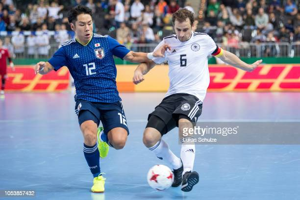 Takashi Morimura of Japan challenges for the ball with Timo Heinze of Germany  during the futsal b27ebac0ab8f6