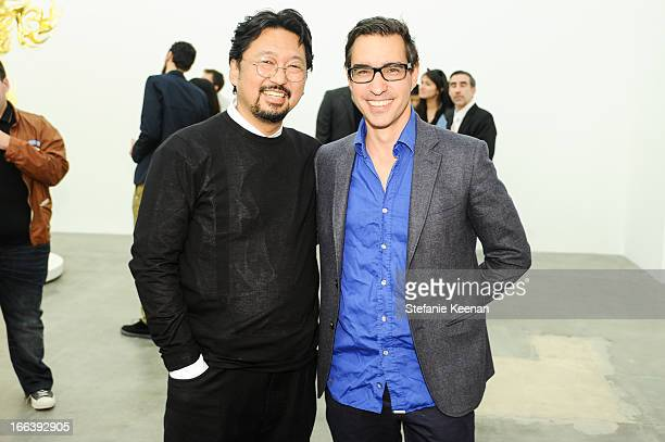 Takashi Murakami and Matthew Monohan attend Takashi Murakami Private Preview And Dinner At Blum Poe on April 11 2013 in Los Angeles California