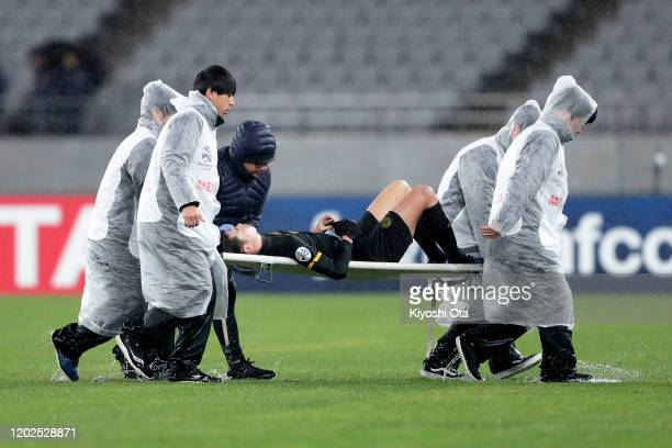Takashi Odawara of CeresNegros is carried off the pitch on a stretcher after an injury during the AFC Champions League play off between FC Tokyo and...