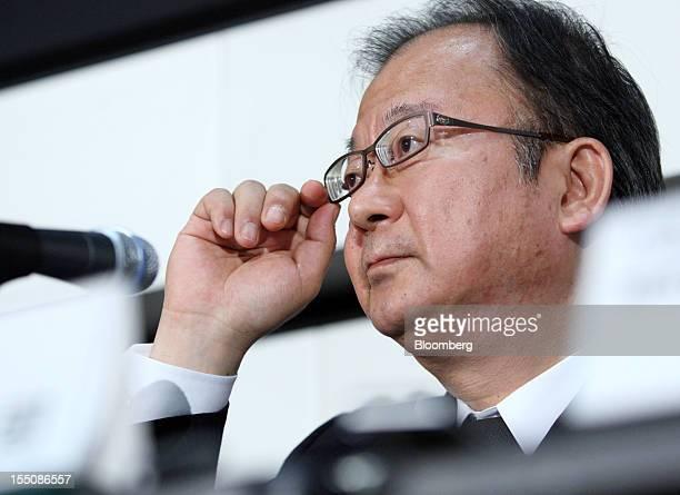 Takashi Okuda president of Sharp Corp adjusts his glasses during a news conference in Tokyo Japan on Thursday Nov 1 2012 Sharp the Japanese TV maker...