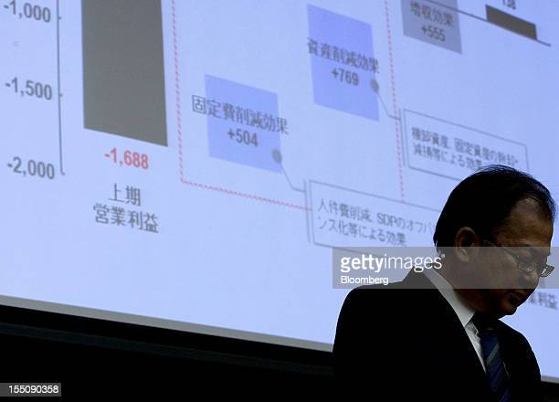 Takashi Okuda president of Sharp Corp attends a news conference in Tokyo Japan on Thursday Nov 1 2012 Sharp the Japanese TV maker that mortgaged its...
