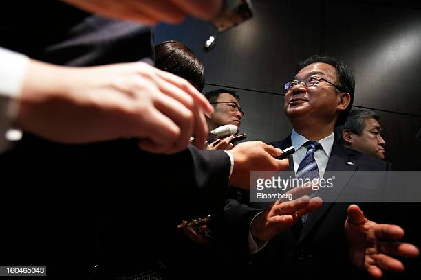 Takashi Okuda president of Sharp Corp gestures as he speaks to journalists following a news conference in Tokyo Japan on Friday Feb 1 2013 Sharp Corp...