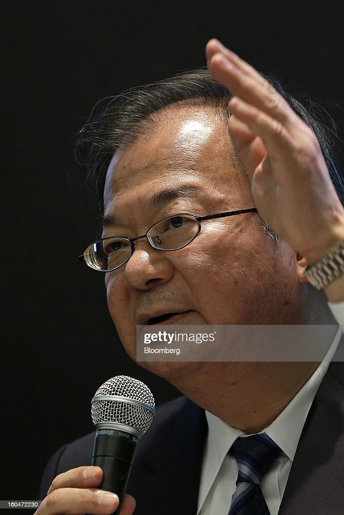 Takashi Okuda, president of Sharp Corp., gestures during a news conference in Tokyo, Japan, on Friday, Feb. 1, 2013. Sharp Corp., the Japanese TV-maker that has warned about its ability to survive, posted a narrower loss helped by job cuts asset sales and a weaker yen. Photographer: Kiyoshi Ota/Bloomberg via Getty Images