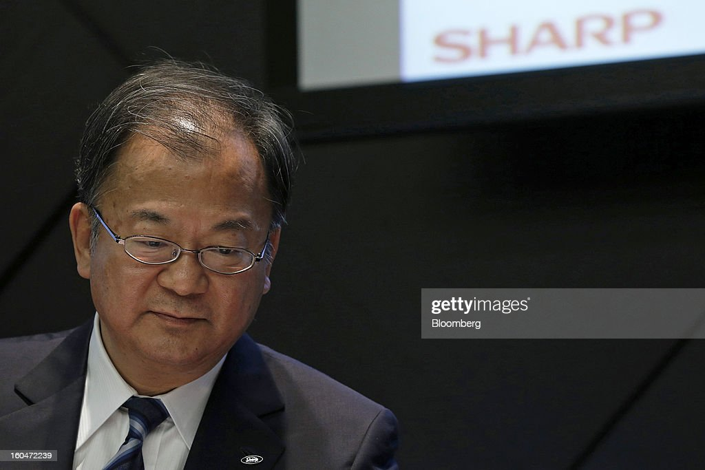 Takashi Okuda, president of Sharp Corp., pauses during a news conference in Tokyo, Japan, on Friday, Feb. 1, 2013. Sharp Corp., the Japanese TV-maker that has warned about its ability to survive, posted a narrower loss helped by job cuts asset sales and a weaker yen. Photographer: Kiyoshi Ota/Bloomberg via Getty Images