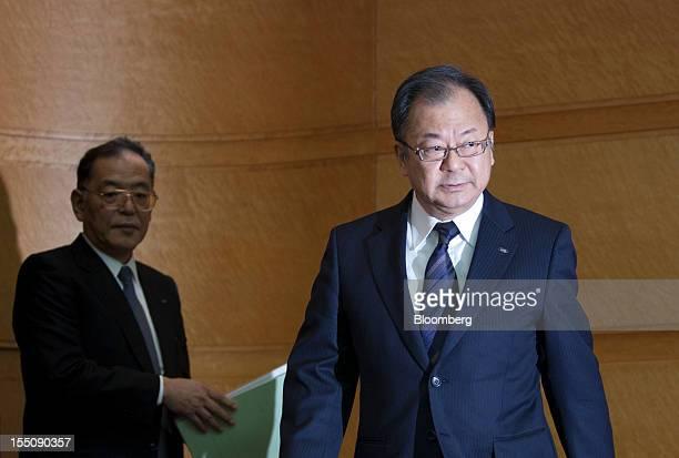 Takashi Okuda president of Sharp Corp right arrives for a news conference in Tokyo Japan on Thursday Nov 1 2012 Sharp the Japanese TV maker that...
