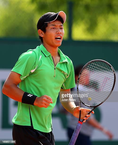 Takashi Saito of Japan celebrates a point during the boys' doubles match between Takashi Saito and Ken Onishi of Japan and Maxime Hamou and Johan...