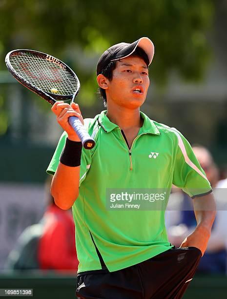 Takashi Saito of Japan in action during the boys' doubles match between Takashi Saito and Ken Onishi of Japan and Maxime Hamou and Johan Sebastien...