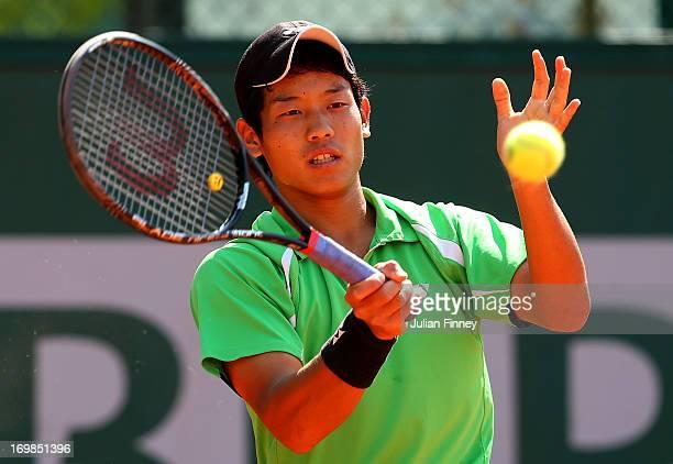 Takashi Saito of Japan plays a forehand during the boys' doubles match between Takashi Saito and Ken Onishi of Japan and Maxime Hamou and Johan...