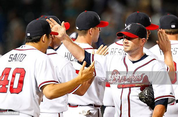 Takashi Sato and Billy Wagner of the Atlanta Braves against the Tampa Bay Rays at Turner Field on June 17 2010 in Atlanta Georgia