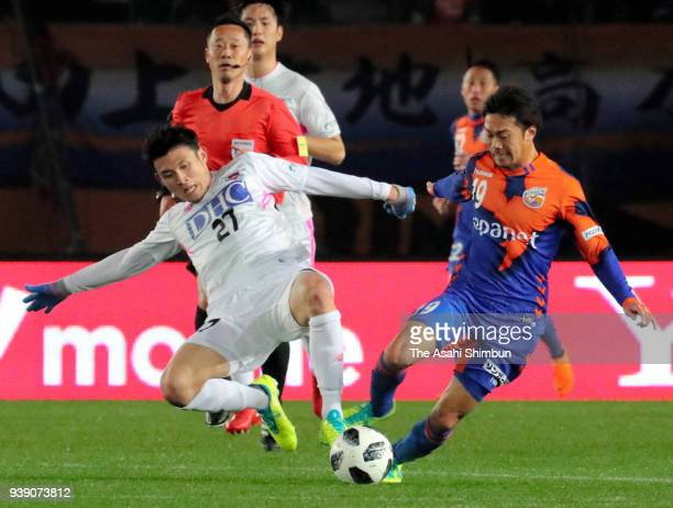Takashi Sawada of VVaren Nagasaki and Ryosuke Tagawa of Sagan Tosu compete for the ball during the JLeague J1 match between VVaren Nagasaki and Sagan...