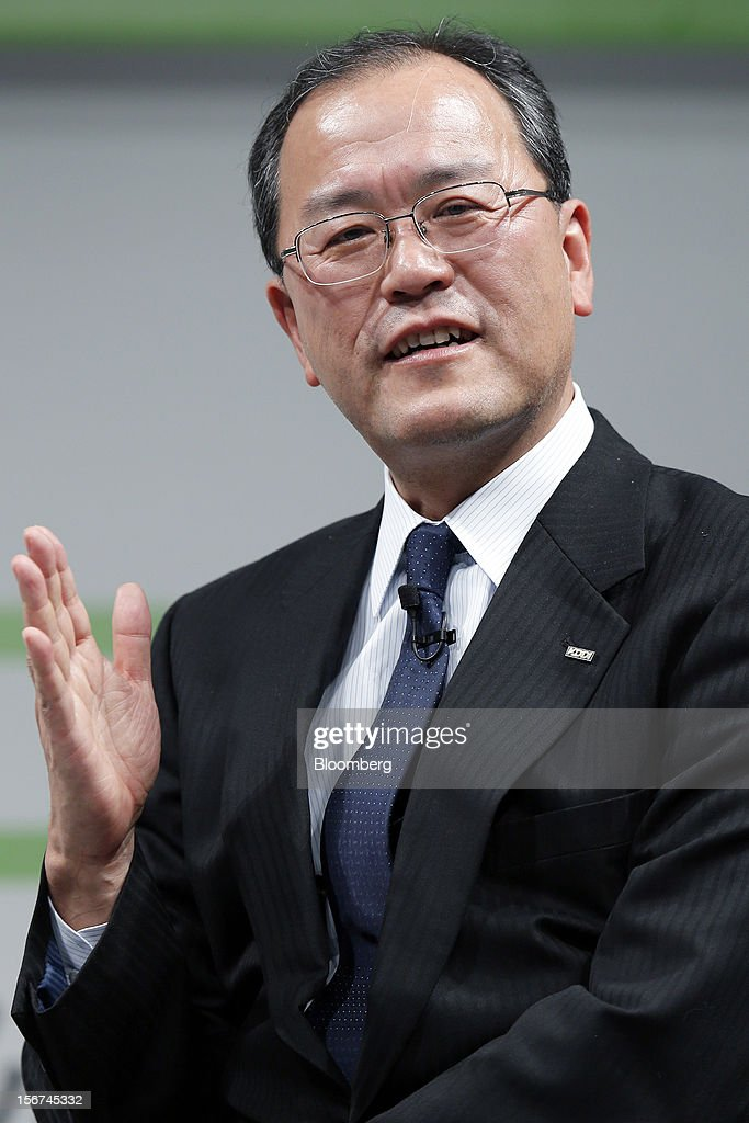 Takashi Tanaka, president of KDDI Corp., speaks during the launch of the HTC J Butterfly smartphone, produced by HTC.Corp., at the unveiling event in Tokyo, Japan, on Tuesday, Nov. 20, 2012. Taiwan's HTC Corp. needs to improve its global brand awareness to gain share in China, and its newly unveiled model is likely to help the vendor do that. Photographer: Kiyoshi Ota/Bloomberg via Getty Images