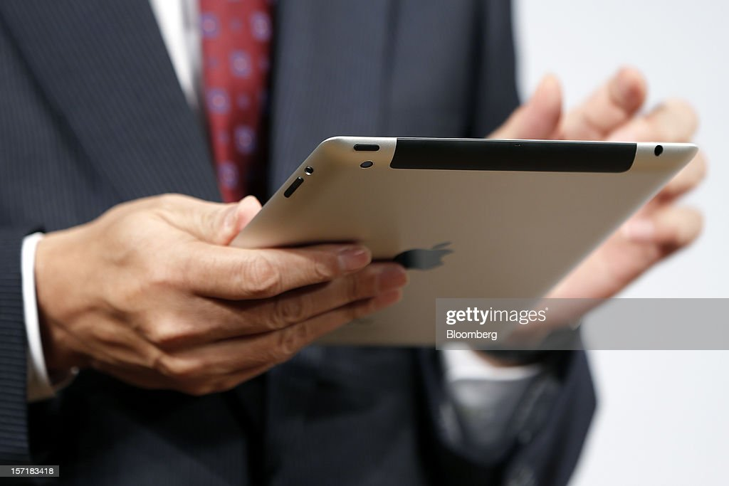 Takashi Tanaka, president of KDDI Corp., uses an Apple Inc. iPad during a launch event at a KDDI store in Tokyo, Japan, on Friday, Nov. 30, 2012. The iPad Mini went on sale at KDDI and Softbank Corp. stores in Japan today. Photographer: Kiyoshi Ota/Bloomberg via Getty Images