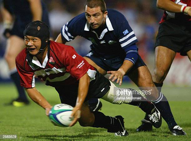 Takashi Tsuji of Japan in action during the Rugby World Cup Pool B match between Scotland and Japan at Dairy Farmers Stadium October 12 2003 in...