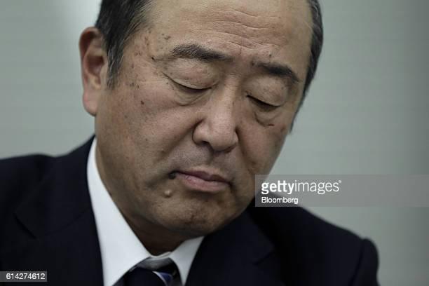 Takashi Tsukioka president of Idemitsu Kosan Co reacts during a news conference in Tokyo Japan on Thursday Oct 13 2016 Japanese refiners Showa Shell...