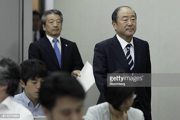 Takashi Tsukioka president of Idemitsu Kosan Co right and Tsuyoshi Kameoka chief executive officer of Showa Shell Sekiyu KK arrive at a news...