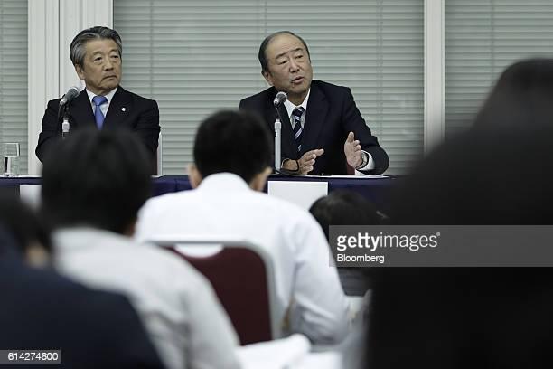 Takashi Tsukioka president of Idemitsu Kosan Co right gestures as he speaks as Tsuyoshi Kameoka chief executive officer of Showa Shell Sekiyu KK...