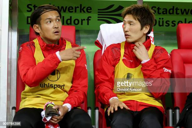 Takashi Usami and Genki Haraguchi sit on the bench during the Second Bundesliga match between Fortuna Duesseldorf and FC Erzgebirge Aue at...