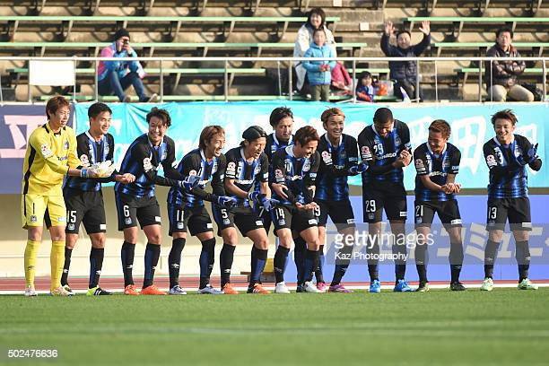 Takashi Usami celebrates his opener with the 'Baby holding dance' together with his team mates after his baby daughter was born on Christmas Eve...